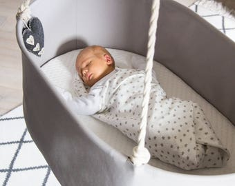 Beautiful & stylish hanging swinging baby cradle / crib. Grey. Natural materials. Perfect first bed for your baby's natural deep sleep