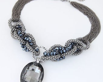 Suzy - Grey statement neckalce with large pendent.