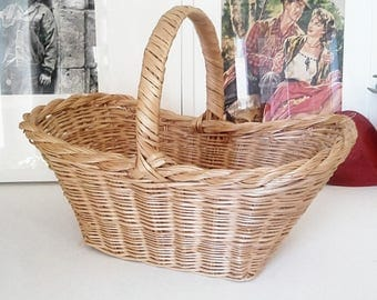 With loop wicker basket.