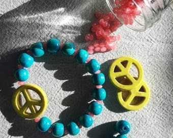 Aqua blue with yellow peace sign