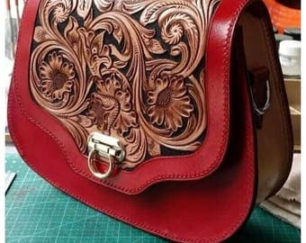 Handbags and purses are hand carved on cow leather...