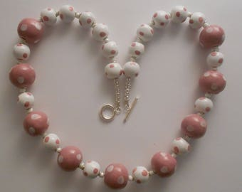 Kazuri fair trade ceramic bead 20 inch necklace in pink and white with spotted beads.