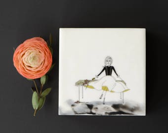 Square Encaustic art. Original whimsical fashion Illustration. Drawing printed on tissue, archival inks.  SFA (Small Format Art) Lounging