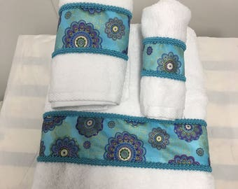 Decorative White with Teal and Purple Trim Towels