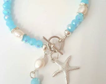Beachy blue beaded bracelet with freshwater pearls and starfish charms