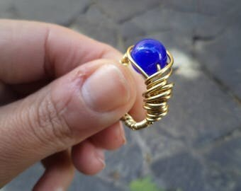 brass wire ring with blue cat eye bead
