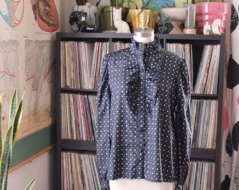 large xl black ruffled blouse with white flowers . 1980s blouse with puffed shoulders and ruffle collar