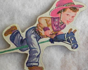 Boy Cowboy Riding Hobby Horse Glittered Wood Christmas Ornament Vintage Book Image