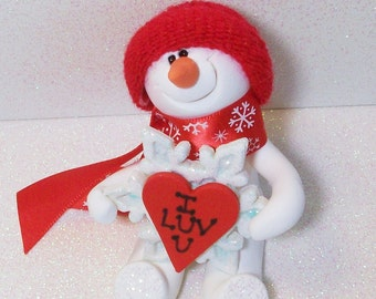 "Snowman ornament: ""I love you flakey"". Polymer clay snowman with polymer snow flake"