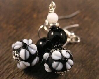 Black lamp work glass with white flowers, snow quartz stone, silver handmade earrings