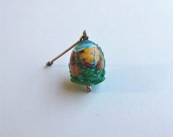 Encased floral garden lampworked glass bead