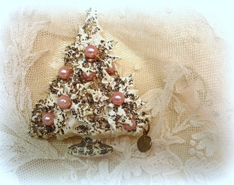 adorable mid century celluloid christmas tree pin with tiny holy medal virgin mary white celluloid gold glitter tiny brass religious medal