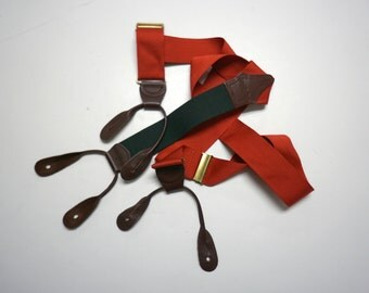 Polo by Ralph Lauren . red and green suspender / braces . leather tabs and solid brass hardware . made in USA