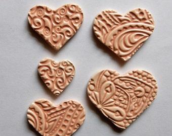 light pink embossed ceramic hearts