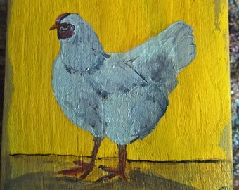 Hen on old wood