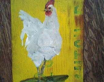 Rooster on old wood