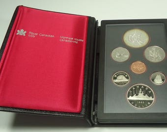 1983 Royal Canadian Mint Double Dollar Uncirculated Specimen 7 Coin Set Indian/Voyager, Coat Of Arms, Caribou, Schooner, Beaver, Maple Leaf
