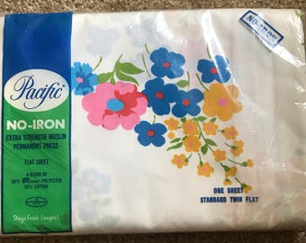 Gorgeous new in package vintage old stock Pacific flat twin sheet in Poppy pink blue and yellow flowers