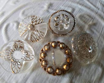 Vintage Buttons - lot of 5 assorted clear glass  gold hand painted medium size pressed glass  flower designs.  ( mar 122 17)