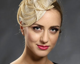 Elegant champagne fascinator hat for your special occasions.