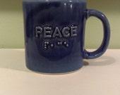 PEACE Braille mug in a dark blue glaze