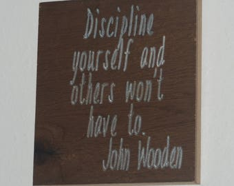 Discipline yourself and others won't have to. John Wooden - Wood carved plaque.   17056