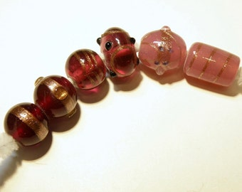 DESTASH - Six (6) Assorted Lampwork Beads: Opaque Dusty Rose and Translucent Cranberry with Goldstone Accents  --  Lot 3K