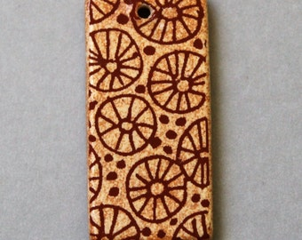 "Rustic Wheels - Ceramic Rectangle Focal Pendant - About 1 1/2"" long"