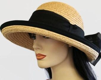 Raffia Straw wide brim straw sun hat with black trim and belt loops and semi sheer black scarf