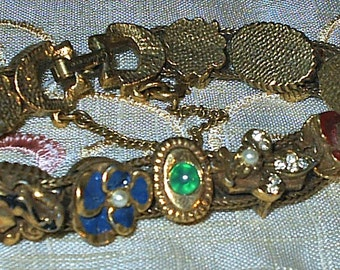 UNIQUE and Oh So Lovely - Vintage Gold Tone Bracelet with safety clasp - Rhinestones, Faux Pearls, and other gems.