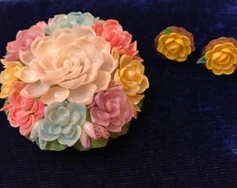 Vintage plastic floral brooch and matching screw back earrings