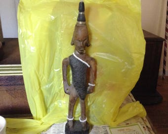 "Hand carved African male warrior, Appx 13"" wearing  beads  very nice"