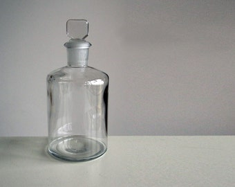 Glass apothecary bottle with stopper / chemist's jar display