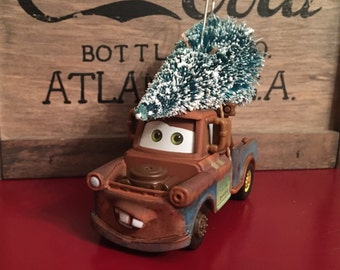 Mater Carrying Christmas Tree Ornament