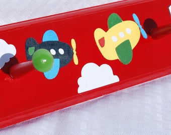 Children's Personalized Coat Rack . Wall Pegs . Airplanes in primary colors . Paul