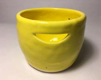 yellow ceramic egg separator