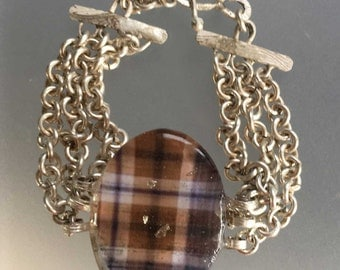 Sterling silver cuff/bracelet with a blue and brown plaid cabochon