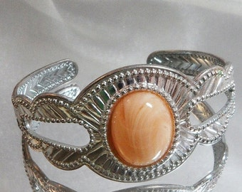 CHRISTMAS SALE Vintage Cuff Bracelet. Silver Tone. Peach Swirl Cabochon.