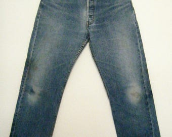 early 1990s hige broken in LEVIS 501 boyfriend jeans, mid / high rise button fly, size 33 x 28