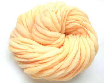Super bulky handspun yarn, 55 yards and 3.45 ounces/ 98 grams, spun thick and thin in peach merino wool