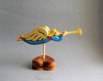 Miniture weather vane with angel blowing a trumpet
