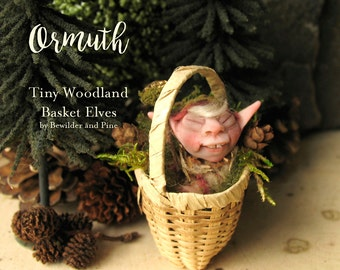 Ormuth - Tiny Elf Figurine in a Basket - Baby Elf - Miniature Polymer Clay Sculpture with Landscaped Basket, Crystal Wand, Pinecones & Moss