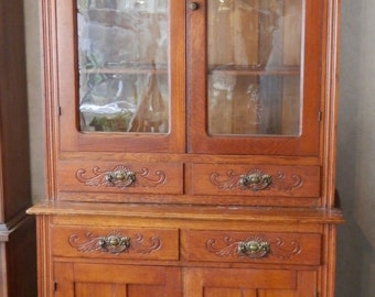 Antique solid oak 2 pc kitchen china cupboard carved, original finish, step back
