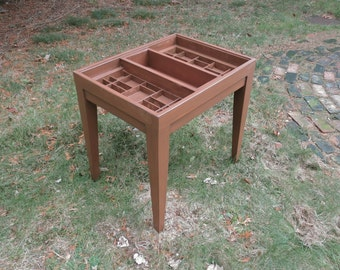 Custom wood side table, with a top made with repurposed printers type boxes in which you can display a collection of shells, jewelry, etc.