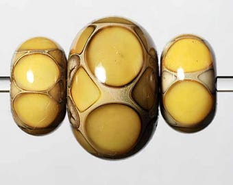 Lampwork Bead Set of Three Beads with Amber and Ivory dots.
