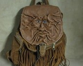 Grichels leather backpack/shoulder bag - rusty brown with blue sailfish eyes