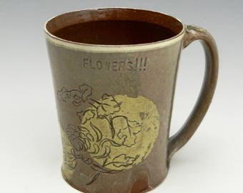Earthenware mug/cup with slip and sgraffito decoration
