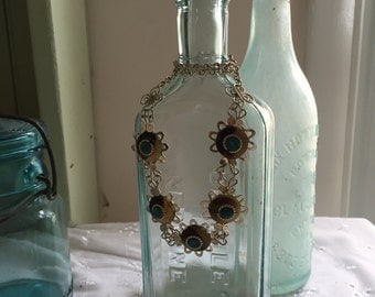 Vintage Aqua bottle with Maui hand made necklace