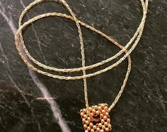 Geometric beaded necklace gold tone square donut pendant