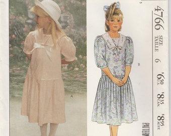 Girls Dress Pattern Drop Waistline Puffed Sleeves Size 6 Uncut McCalls 4766 Laura Ashley